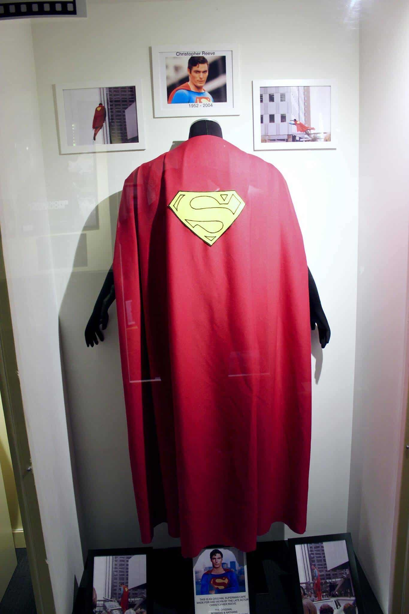 Inside a large glass case is the superman cape worn by Christopher Reeves in the superman movies.