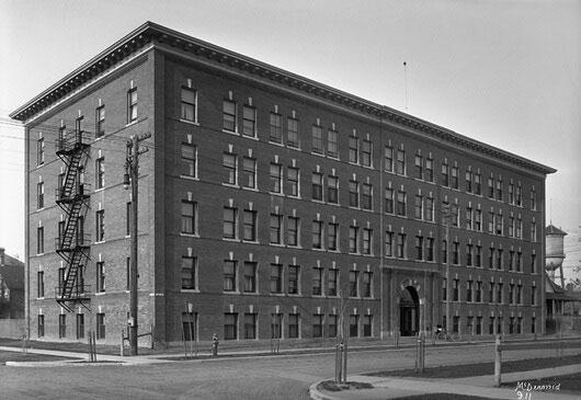 Historic black and white photo of the Arlington Apartment Block in Edmonton Alberta Ghost Tour