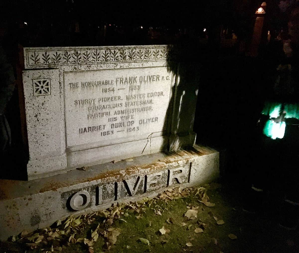 Grave stone of Frank Oliver in the Edmonton Municipal Museum at night.