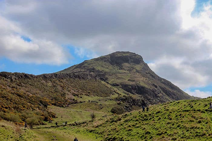 Arthur's Seat lined with people climbing in Edinburgh, Scotland