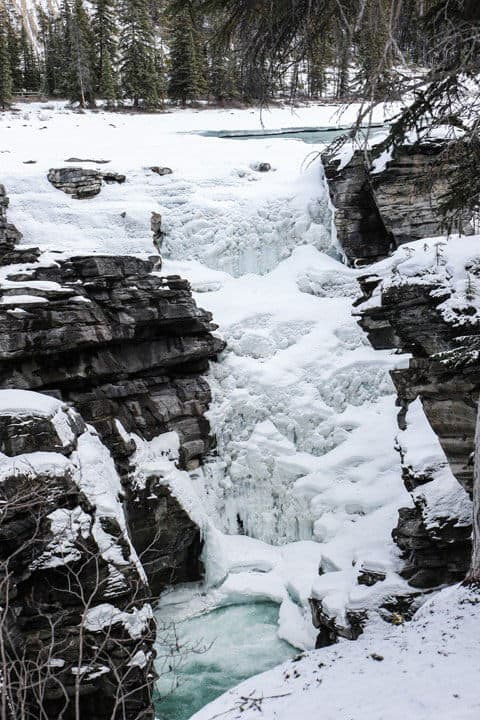 Frozen snowy Athabasca Falls in Jasper National Park in the winter