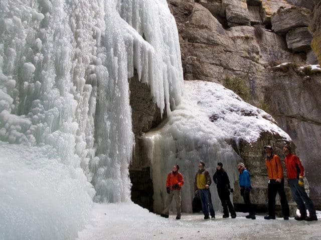Maligne Canyon Ice Walk - people looking up at the frozen water fall in Maligne Canyon