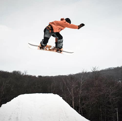 A man snowboarding on a snowy hill