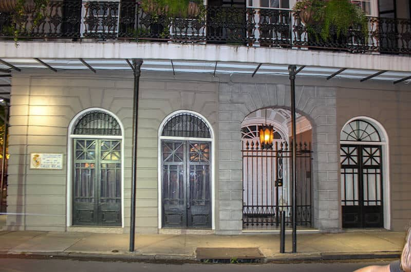 The entrance into the LaLaurie Mansion on the right of the picture. (white door)