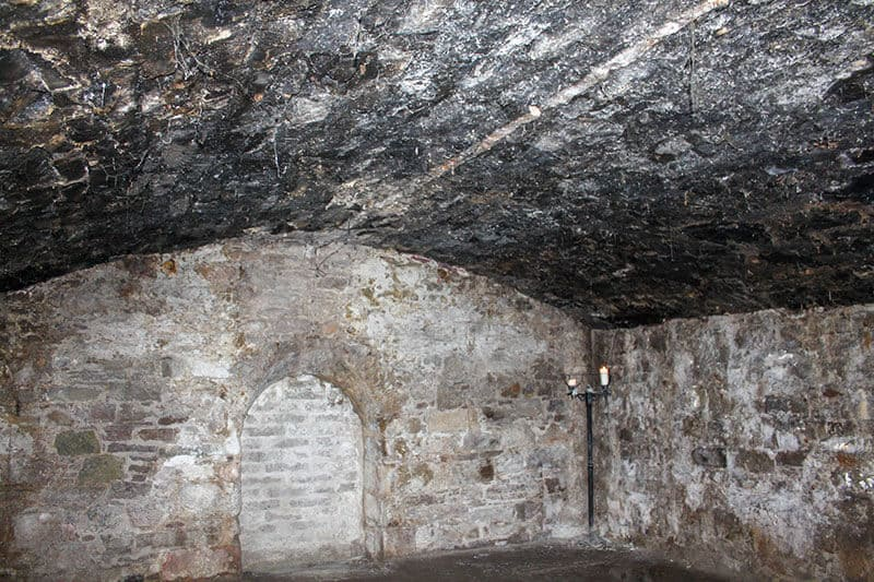 Dark gloomy Edinburgh Vault that lays beneath the historic Royal Mile