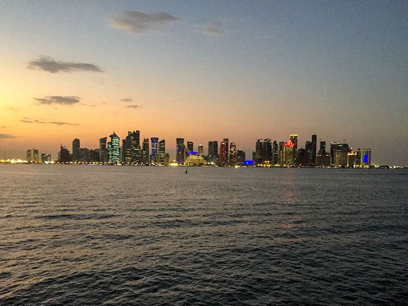 Doha skyline at night from the sea