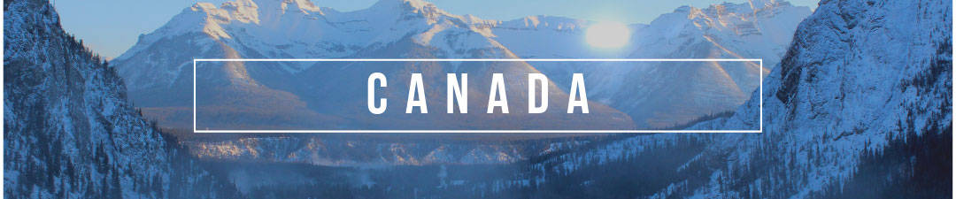 Canada Blog Posts - Rocky Mountains in a blue light with Canada in the front