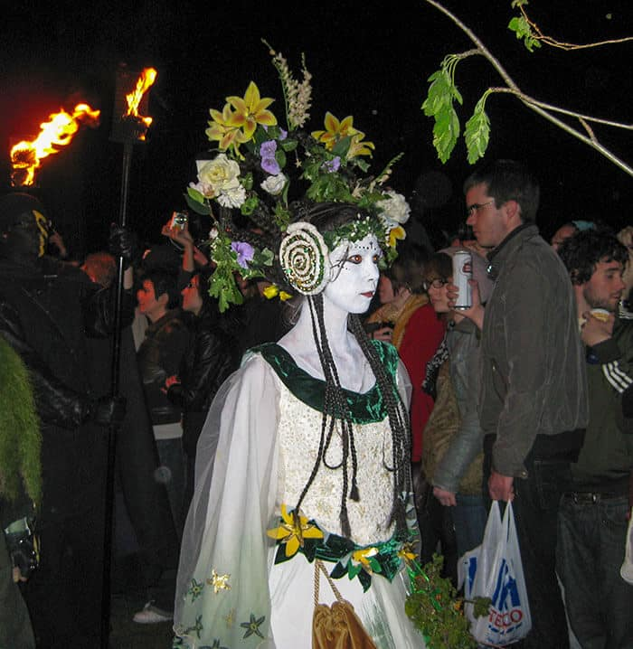 Woman in white decorated in flowers at the Beltane Fire Festival on Calton Hill