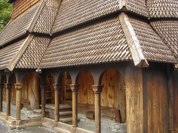 The side of Fantoft Stave Church showing the wooden columns that surround the entrance