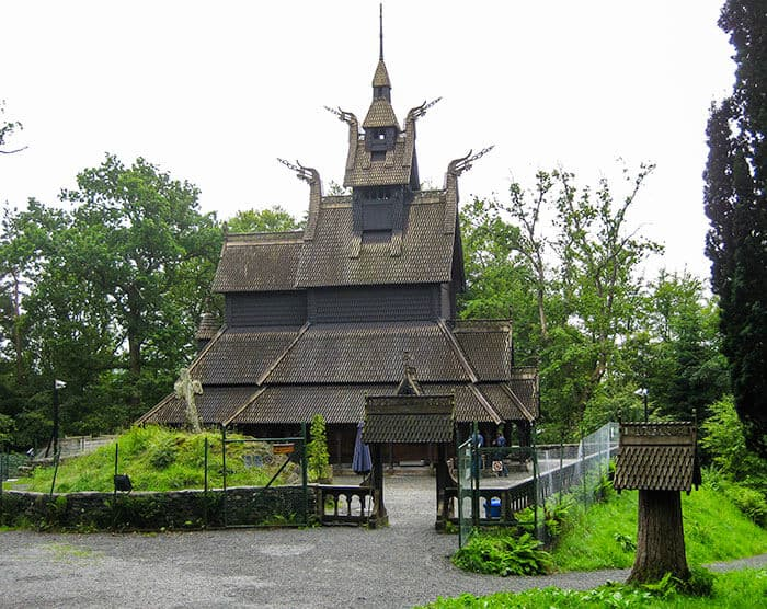 Fantoft Stave Church from the side - dark brown wooden church with norse designs.