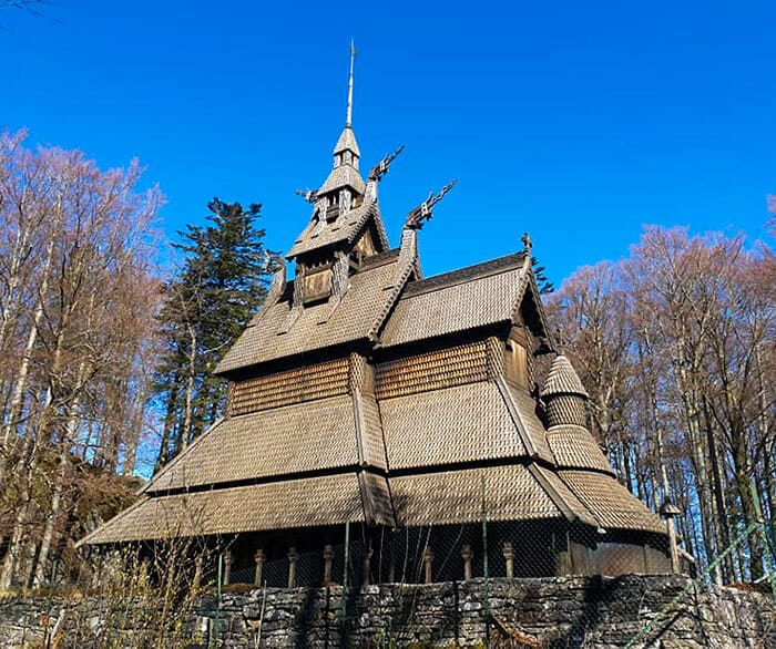 Fantoft Stave Church in the sun with a beautiful blue sky in the background