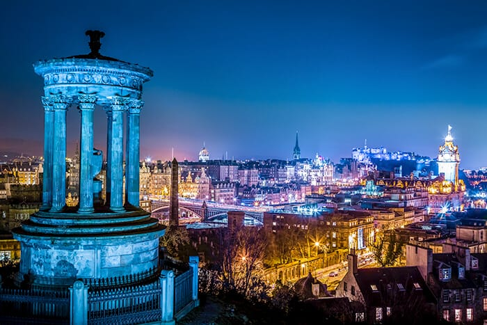 Edinburgh Skyline at night from Calton Hill - overlooking the city full of spooky, scary and haunted attractions.