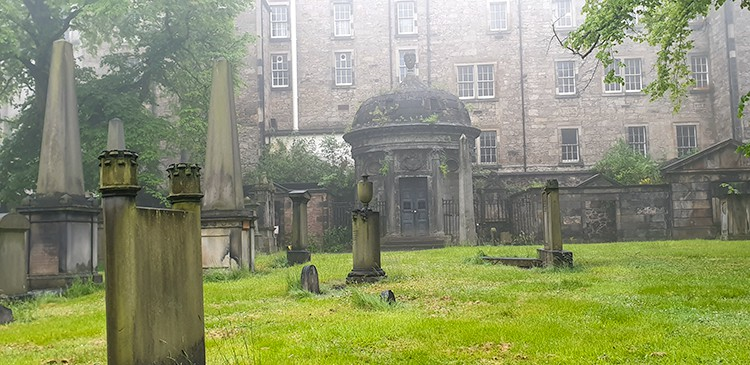 misty foggy graveyard with the haunted black mausoleum in Grayfriars Kirkyard