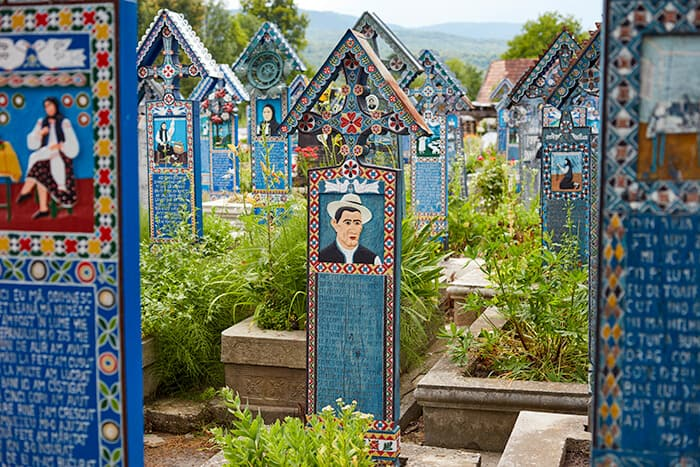 An ocean of blue cemetery stones decorated with colorful images of the deceased. Spooky and haunted Romania location.