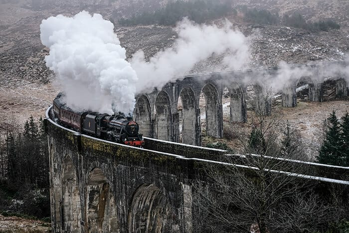Steam Train seen in Harry Potter - on the bridge in Scotland on the glenfinnan viaduct