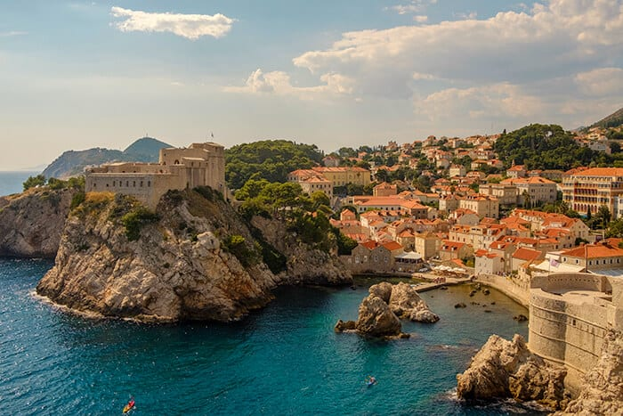 View of King's Landing in Dubrovnik Croatia from afar - view of the blue water with the city in the background.