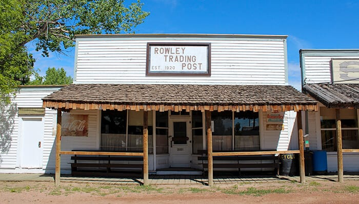 Rowley Trading Post - Building on Main Street - White Wooden Building with Rowley Trading Post Sign written on the top of the building