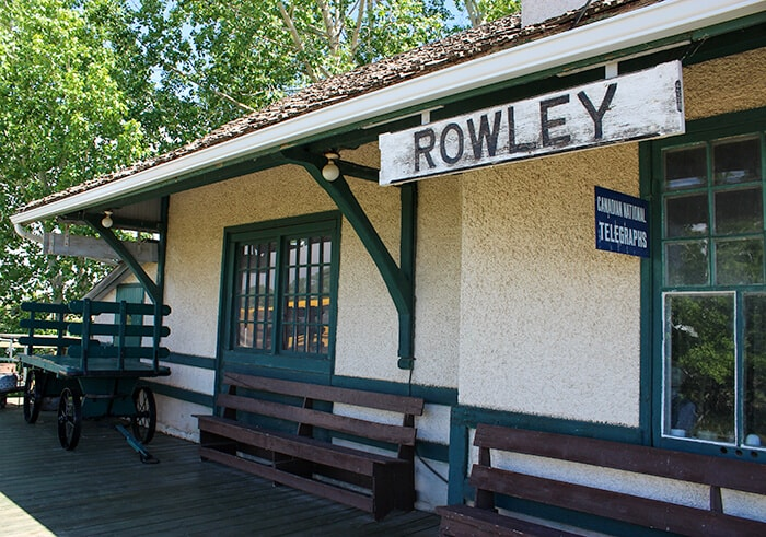 Historic Ghost Town of Rowley in Albertas Train Station. Rowley written on a white wooden plank of wood.