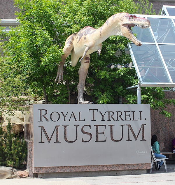 Entrance to Royal Tyrell Museum. Museum sign with a large dinosaur on the sign.