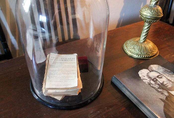 A original copy of Cotton Mathers book on witchcraft sits protected in a glass case in the Witch House
