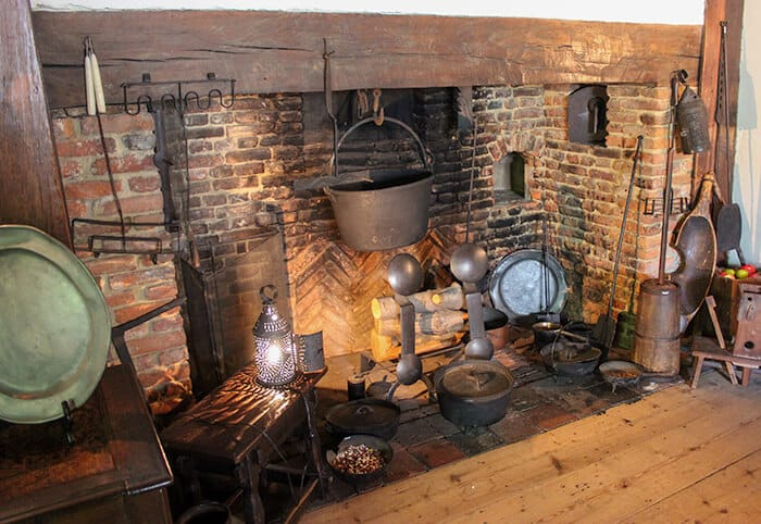 Brick Fireplace with several kitchen items sitting within the fireplace inside the Salem Witch House