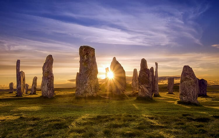 Callanish stones at sunset - Pros and Cons of Moving to and living in Scotland is seeing beautiful landscapes like the circle of stones at sunset