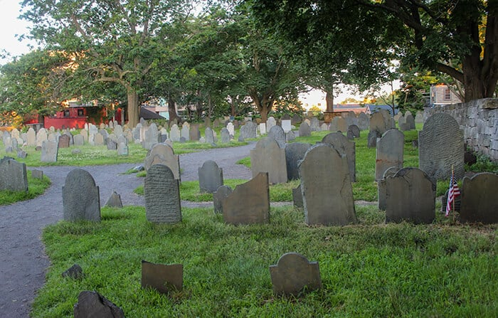 Hundreds of old weathered and aged from time cemetery stones in the Old Burying Point Cemetery
