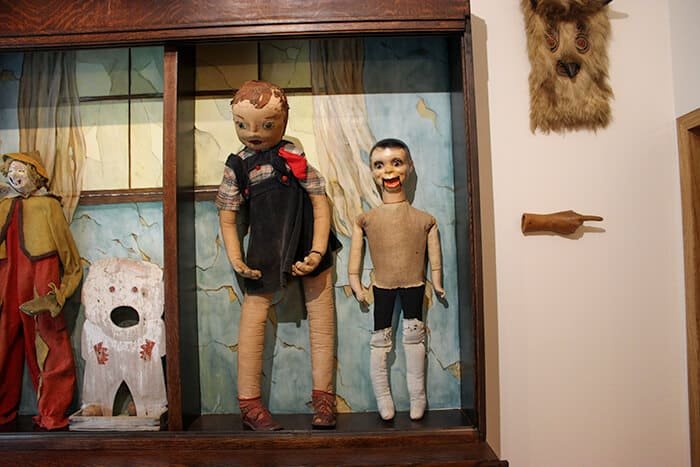 Various dolls on display in the Museum of Fear and Wonder