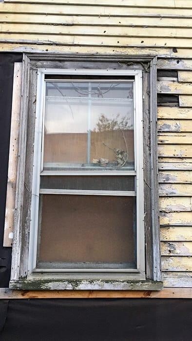 Window on the yellow Grimshawe House