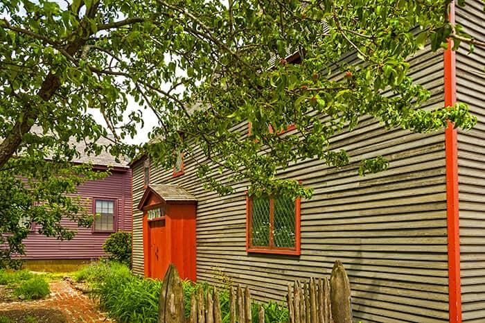 Old wooden building with red door in Salem - Pickman House
