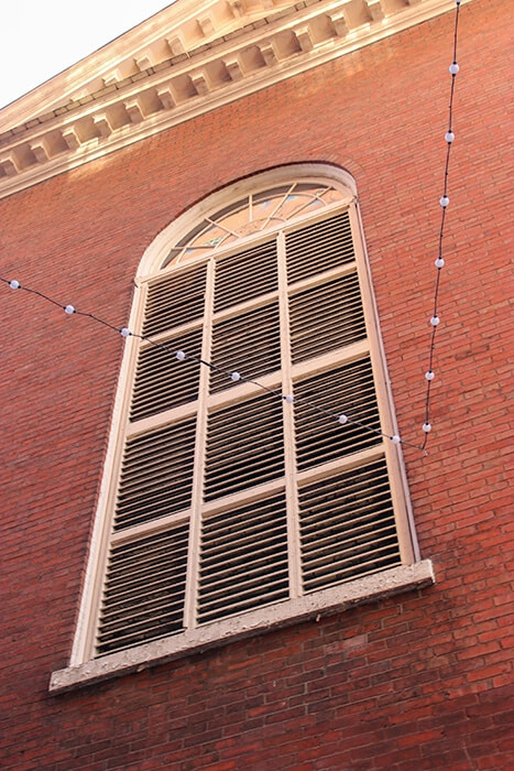 Window on the second level of the brick building of the haunted restaurant Rockafellas in Salem