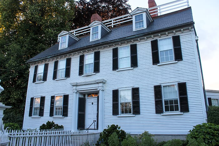 Large white mansion with black window shutters - the Ropes Mansion is one of Salem's haunted sites