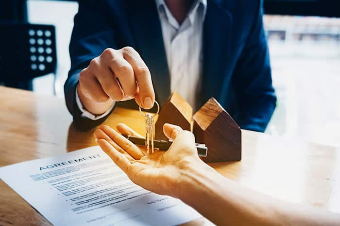 Letting agent in Edinburgh handing over they keys after signing a contract