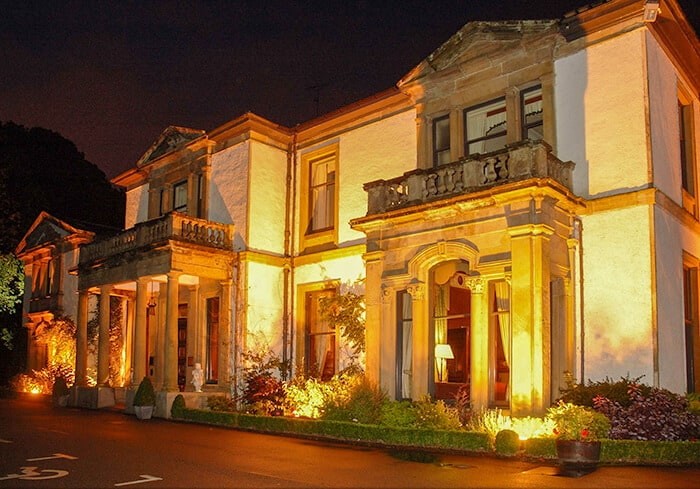 The front entrance of the haunted hotel Macdonald Norwood Hall Hotel at night