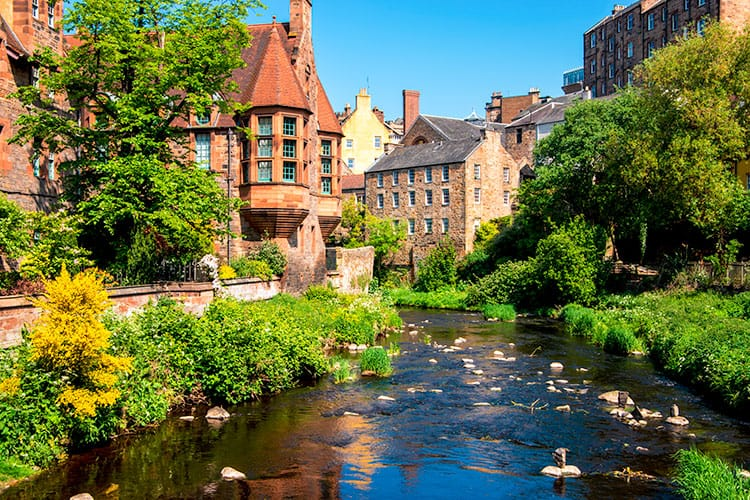Things to do in Dean Village - brick buildings surrounding a body of water