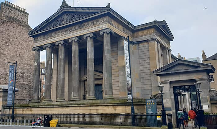 The front of the Surgeons Hall Museum in Edinburgh - huge building with 5 large columns on the front