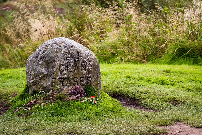 Memorial stone with Clan Fraser written on it, the Culloden Battlefield is the marshy warzone from the Battle of Culloden and is a dark travel and spooky places to visit in Scotland