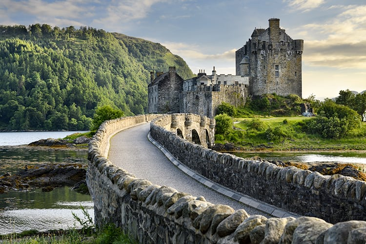 Eilean Donan Castle in Spring misty morning. dark travel and spooky places to visit in Scotland.