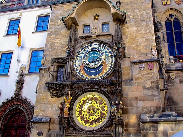 Pragues Astronomical Clock - intricate clock details featuring four moving automatons and rotating statues of the 12 apostles.