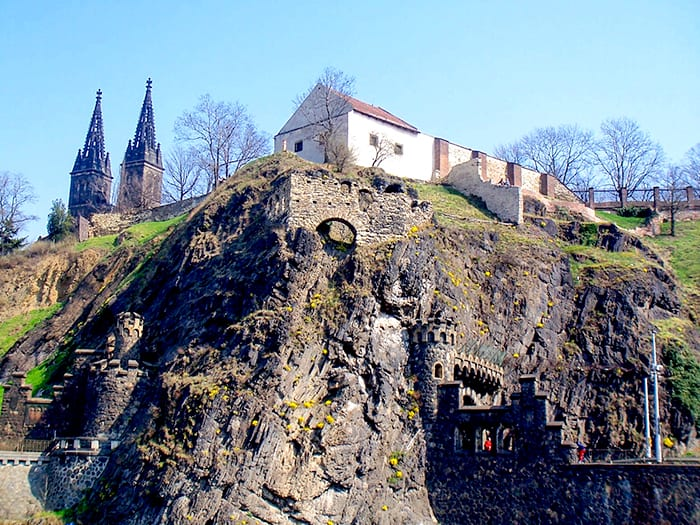 View of the Vysehrad complex from the river. One of the most haunted places in Prague - the ruins and buildings are built into the rocky hill.