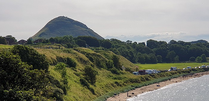 large hill with the beaches of North Berwick in the foreground