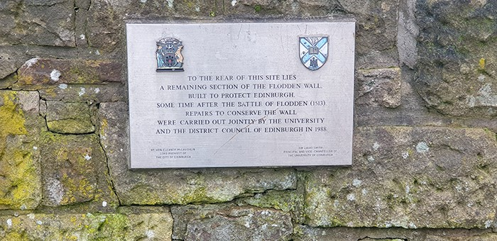 A plaque showing that the wall was repaired in 1988 by the Council of Edinburgh.