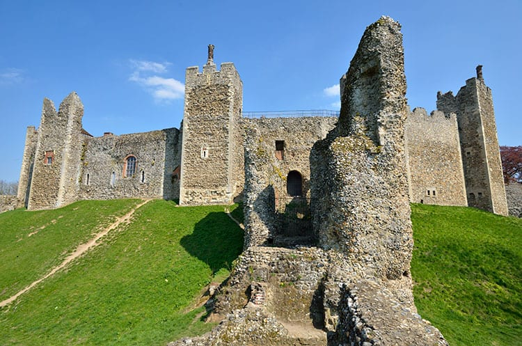 Framlingham Castle - almost looks like ruins of an ancient castle sitting on bright green grass.