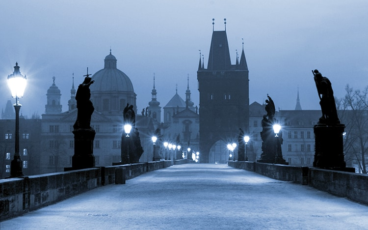 Pragues Charles Bridge at Night, blue light and silhouettes of statues. Ghost Stories and Legends from Prague