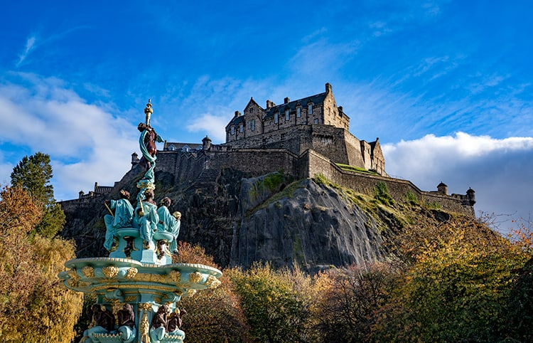 Edinburgh Castle on top of Castle Hill from Princes Street Gardens. The Ross Fountain is on the left with the castle in the background.