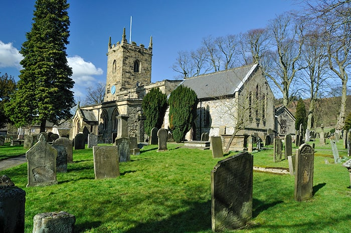 Eyam is one of Places to Visit with a Dark History in England. Church and graveyard in the Plague Village.