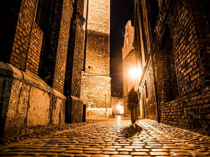 A dark street in London with a cobbled road