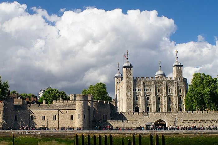 Tower of London is one of the places with dark history in England. Large castle like building.