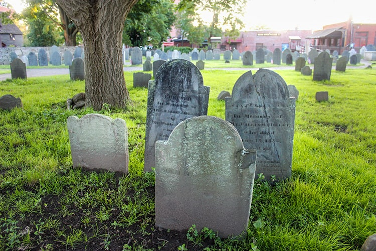 Four headstones in the haunted cemetery in Salem Ma