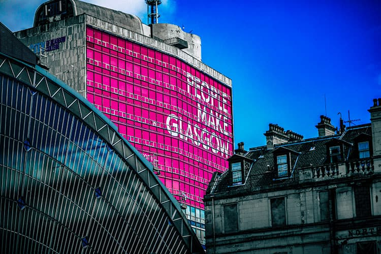 Building in Glasgow with large sign that says People Make Glasgow
